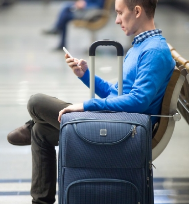 man with luggage waiting